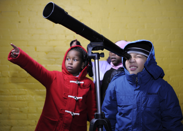 Kids looking through telescope.